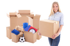 Moving day concept - beautiful woman with brown cardboard boxes. With stuff isolated on white background Royalty Free Stock Photography