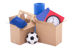 Moving day concept - brown cardboard boxes with stuff isolated o Stock Images