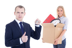 Moving day concept - business man giving key to woman with cardb Stock Image