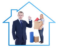 Moving day concept - businessman real estate agent giving key to Royalty Free Stock Photography