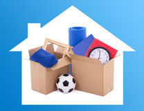 Moving day concept - cardboard boxes with stuff Royalty Free Stock Photo