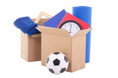 Moving day concept - cardboard boxes with stuff isolated on whit royalty free stock photo