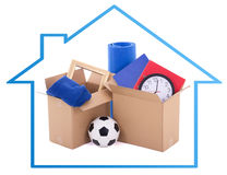 Moving day concept - cardboard boxes with stuff isolated on whit Stock Photos