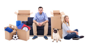 Moving day concept - couple and cardboard boxes with stuff isola Stock Photos
