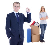 Moving day concept - handsome business man with key and young wo Royalty Free Stock Image