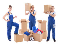 Moving day concept - people in blue workwear with cardboard boxe Royalty Free Stock Image