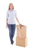 Moving day concept - woman with cardboard boxes isolated on whit. E background Stock Images