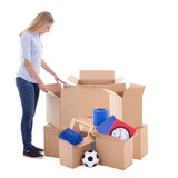 Moving day concept - woman packing cardboard boxes isolated on w Stock Photography