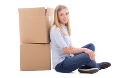 Moving day concept - woman sitting with cardboard boxes isolated. On white background Royalty Free Stock Photos