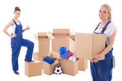 Moving day concept - women in blue workwear with cardboard boxes Royalty Free Stock Photos