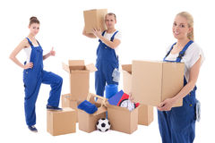 Moving day concept - workers in blue workwear with cardboard box royalty free stock image