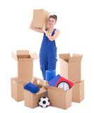 Moving day concept - young attractive woman in blue workwear wit. H cardboard boxes isolated on white background Stock Photography