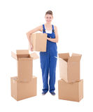 Moving day concept - young attractive woman in workwear with car. Dboard boxes isolated on white  background Stock Photos