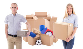 Moving day concept - young couple with brown cardboard boxes wit royalty free stock photography