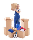 Moving day concept - young handsome man in blue workwear with ca Royalty Free Stock Images