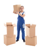 Moving day concept - young man in blue workwear with cardboard b Stock Photography