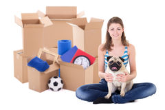 Moving day concept - young woman with brown cardboard boxes and Royalty Free Stock Image