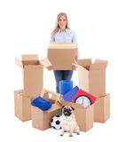 Moving day concept - young woman with brown cardboard boxes and Stock Photos
