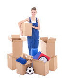 Moving day concept - young woman in workwear with cardboard boxe Royalty Free Stock Photography