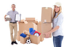moving day or delivery concept - man and woman with brown cardboard boxes with stuff isolated on white royalty free stock photos