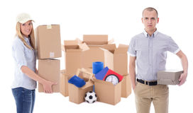 Moving day or delivery concept - young man and woman with brown. Moving day or delivery concept - young men and women with brown cardboard boxes with stuff Stock Image