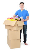 Moving day. man with cardboard box Royalty Free Stock Photography