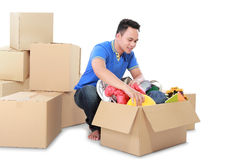 Moving day. man with cardboard box Stock Photography
