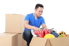 Moving day. man with cardboard box Stock Images