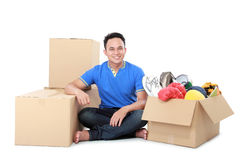 Moving day. man with cardboard box stock photos