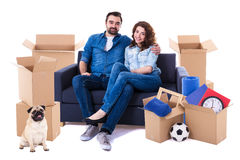 Moving day and new home concept - lovely couple sitting on sofa Royalty Free Stock Photography