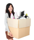 Moving day. woman with her stuff inside the cardboard box Royalty Free Stock Photo