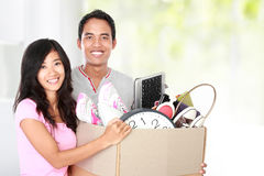 Moving day. woman with her stuff inside the cardboard box Stock Images
