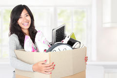 Moving day. woman with her stuff inside the cardboard box. Woman with her stuff inside the cardboard box ready to move. moving day concept Royalty Free Stock Images