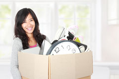 Moving day. woman with her stuff inside the cardboard box. Woman with her stuff inside the cardboard box ready to move. moving day concept Stock Photography