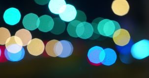 Moving defocused lightson big city stock video