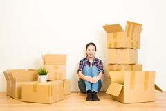 Moving delivery accommodation and people. Concept - smiling young woman with cardboard box at home. mixed race asian chinese model Royalty Free Stock Photography