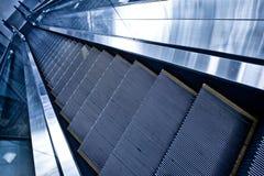 Moving down escalator Stock Image