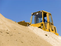 Moving earth. A construction vehicle moving earth Stock Image