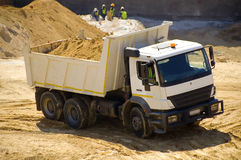 Moving earth. A construction vehicle moving earth Stock Images