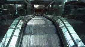 Moving empty escalator. Moving iron empty escalator stairs stock video footage
