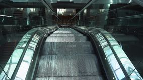 Moving empty escalator. Moving iron empty escalator stairs, slow motion stock video