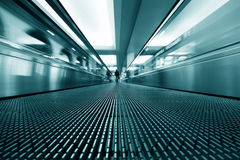 Moving escalator Stock Images