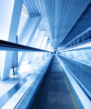 Moving escalator in airport Royalty Free Stock Photos