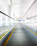 Moving escalator in an airport Royalty Free Stock Photo