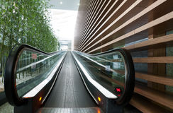 Moving escalator in an airport. In China Stock Photo
