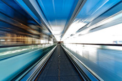 Moving escalator in airport Stock Photos