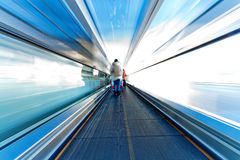 Moving escalator in airport. Fast moving escalator in airport Royalty Free Stock Image
