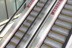 Moving escalator in airport Stock Images
