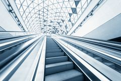 Moving escalator in the business center Stock Photography