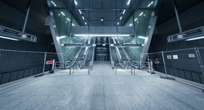 Moving escalator in the business center Stock Images